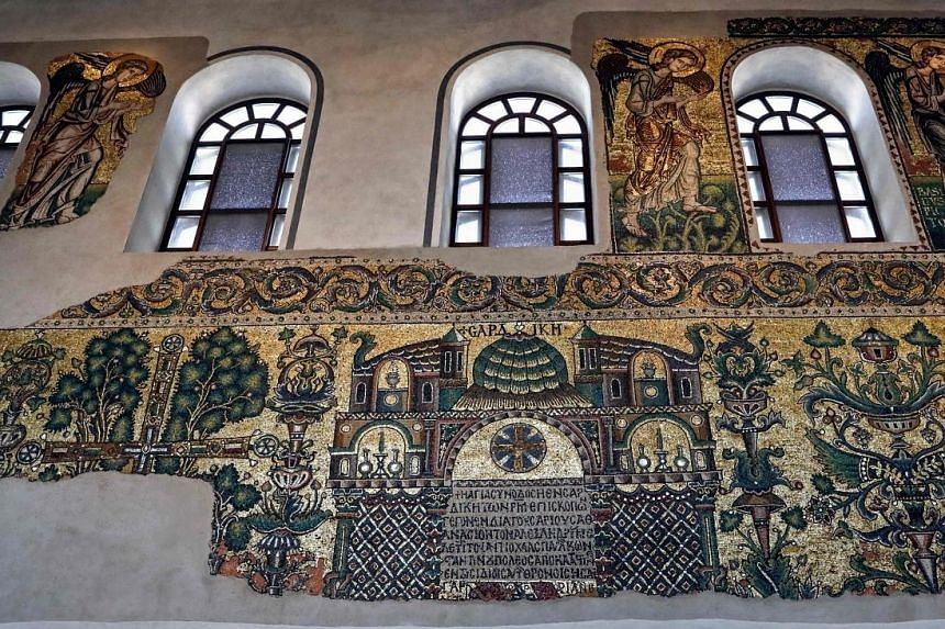 The restored 12th-century mosaics in the Church of the Nativity in the Israeli-occupied West Bank city of Bethlehem. Some 125 sq m of what was once 2,000 sq m of glittering gold and glass has been preserved.