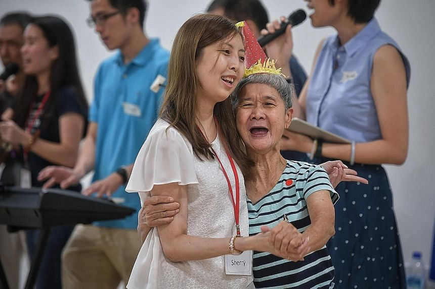 Ms Sherry Soon, who set up Be Kind SG last year, with 69-year-old How Shap Nooi, a resident of a home that the group visits.