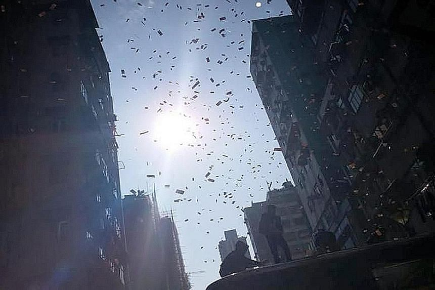 Videos posted online suggest that the notes were thrown from the roof of a building onto Fuk Wa Street in Sham Shui Po, Hong Kong, last Saturday.