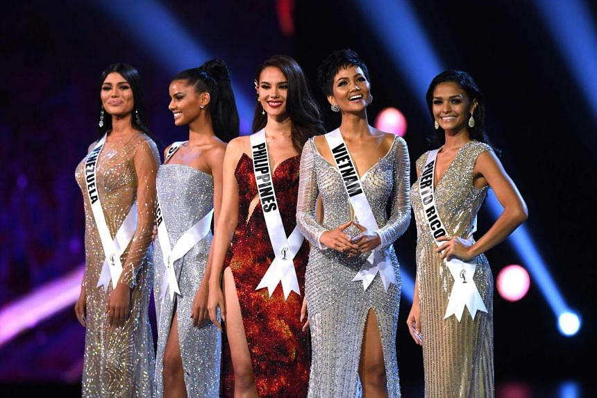 (From left) Sthefany Gutierrez of Venezuela, Tamaryn Green of South Africa, Catriona Gray of the Philippines, H'Hen Nie of Vietnam and Kiara Ortega of Puerto Rico stand on stage after being selected as the top five finalists.