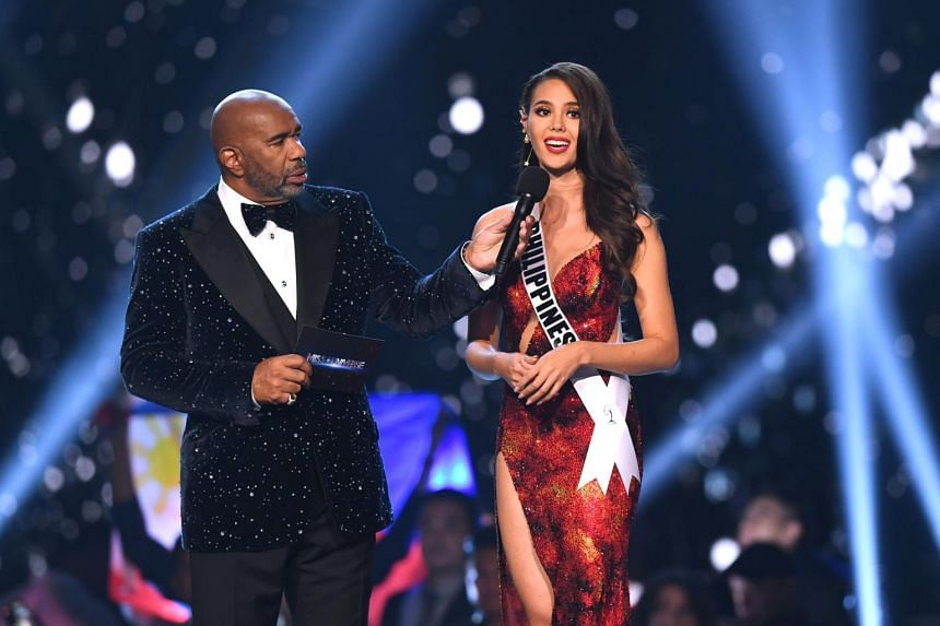 Catriona Gray speaks during the interview of the top three finalists with host Steve Harvey.
