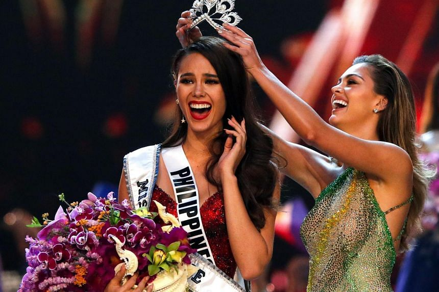 Catriona Gray of the Philippines receiving her Miss Universe 2018 crown from last year's winner, Demi-Leigh Nel-Peters.