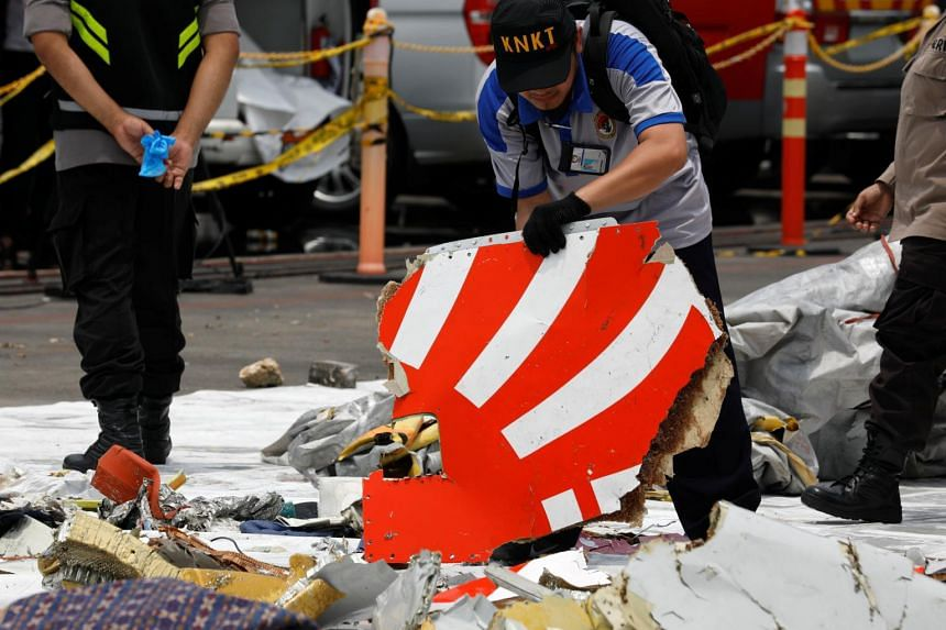 Rescue workers load up recovered debris of Lion Air flight JT610 onto a truck at Tanjung Priok port in Jakarta, Indonesia, on Nov 2, 2018.