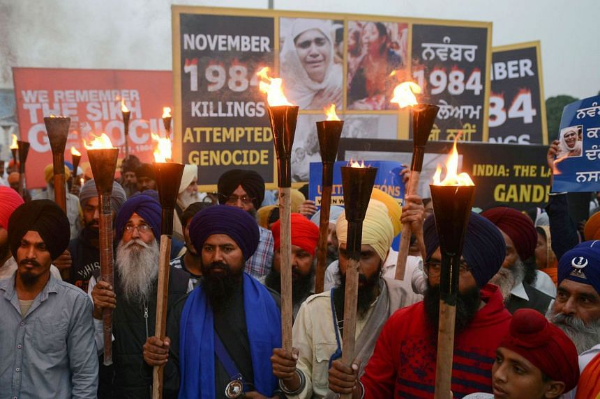 Activists of the Dal Khalsa radical Sikh organisation march at a protest to commemorate the 1984 anti-Sikh riots in Amritsar, India, on Nov 3, 2018.