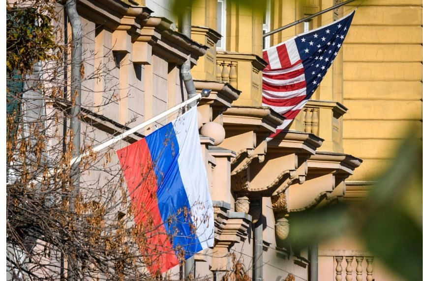 File photo showing a Russian flag next to the US embassy building in Moscow, on Oct 22, 2018.