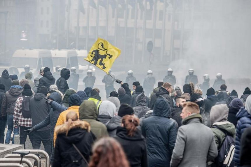 Demonstrators clash with Belgian riot police during a march called by the right-wing Flemish party Vlaams Belang and a dozen organisations that are against the UN Marrakech global compact on migration in Brussels on Dec 16, 2018.