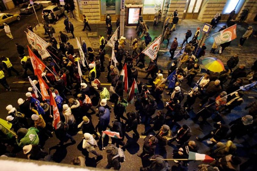 Members and sympathisers of several trade unions, political parties and civil organisations march in protest in front of the Western Railway station in Budapest on Dec 16, 2018.
