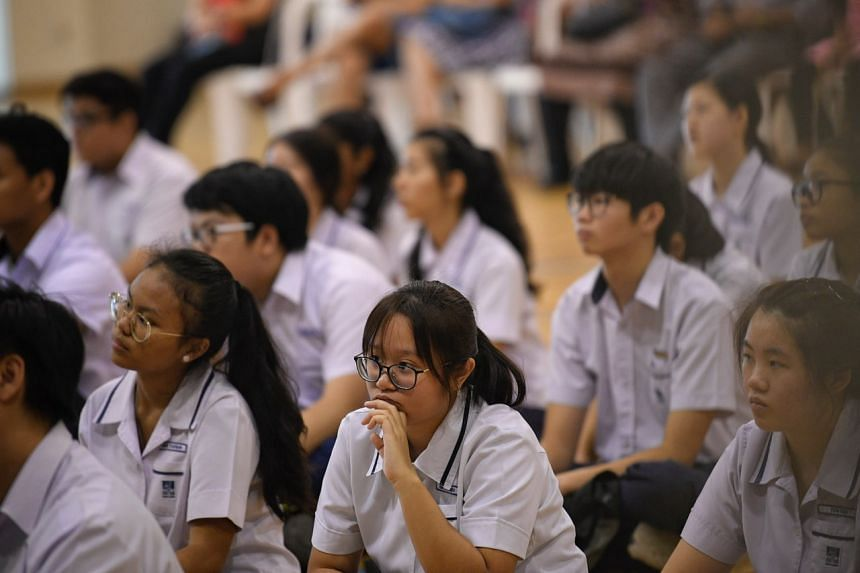 Students wait for their N-level results at Serangoon Garden Secondary School on Dec 17, 2018.