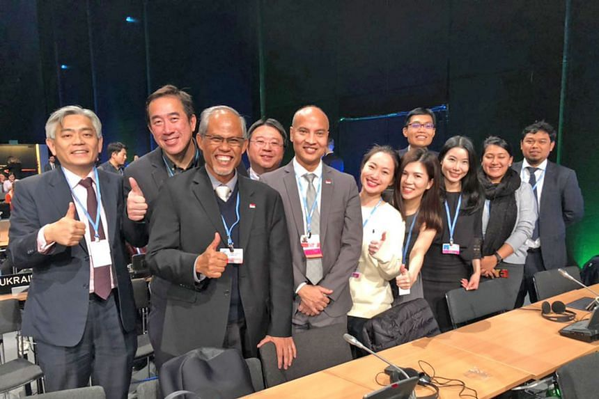 The Singapore team was all smiles after the deal. Among them are (from left) Mr Albert Chua, Permanent Secretary at the Ministry of the Environment and Water Resources (MEWR); Mr Cheah Sin Liang, deputy director of international policy at the Nationa