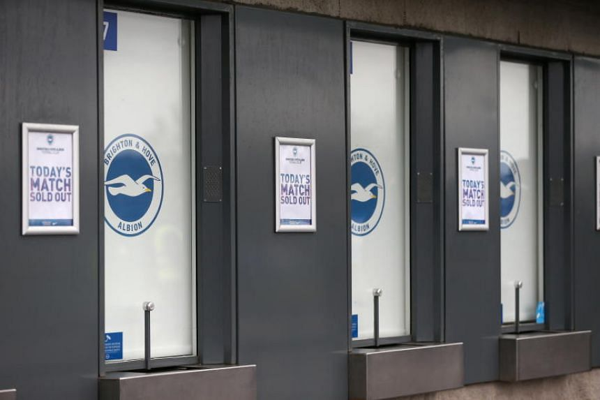 """""""Sold Out"""" signs on the ticket office before the English Premier League football match between Brighton Hove Albion and Chelsea at the Amex Stadium in Brighton, Britain, on Dec 16, 2018."""