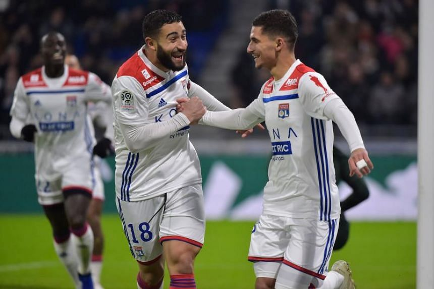 Lyon's Houssem Aouar (right) celebrates after scoring a goal with teammate Nabil Fekir during their Ligue 1 match at the Groupama Stadium in Decines-Charpieu, near Lyon, on Dec 17, 2018.