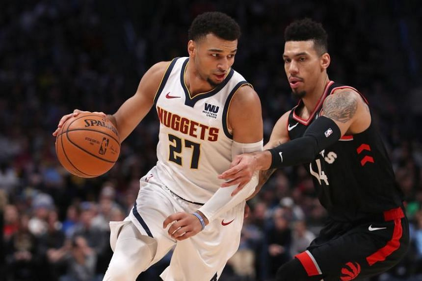 Jamal Murray of the Denver Nuggets drives against Danny Green of the Toronto Raptors at the Pepsi Center in Denver, Colorado, on Dec 16, 2018.