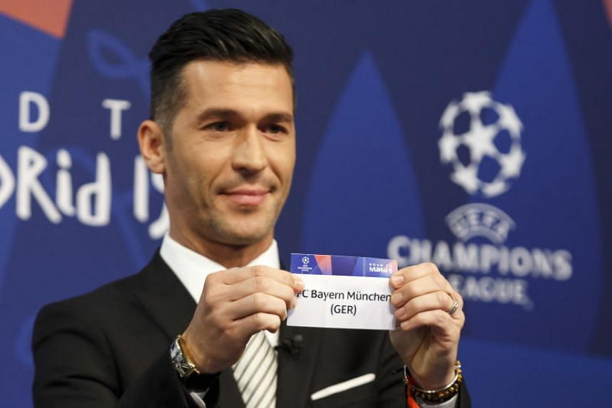 Former Spanish football player Luis Garcia, ambassador for the Champions League, shows the lot of Bayern Munich during the drawing ceremony of the Champions League round of 16 matches at the Uefa headquarters on Dec 17, 2018.