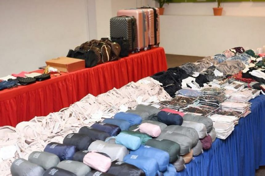 All four were arrested at a hotel on Sept 16 for the theft of more than 1,400 pieces of clothing, the biggest haul to date involving a shoplifting syndicate.