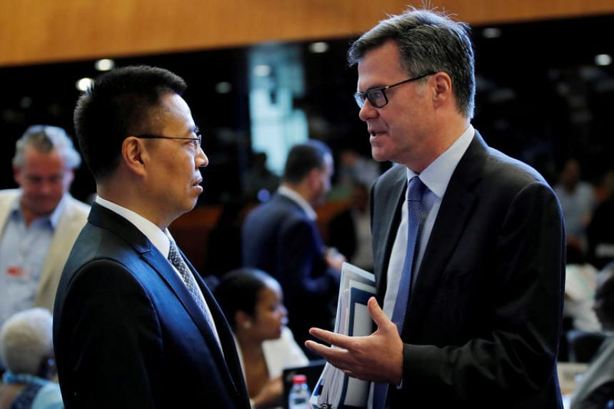 File photo of US Ambassador to the World Trade Organisation (WTO) Dennis Shea (right) with Chinese Ambassador to the WTO Zhang Xiangchen, before the General Council meeting at the WTO headquarters in Geneva, on July 26, 2018.