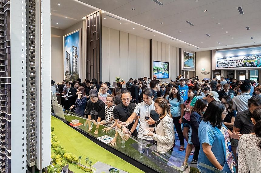 Visitors at the launch of city-fringe development Whistler Grand last month. The seven new launches - 3 Cuscaden, Arena Residences, Belgravia Green, Kent Ridge Hill Residences, The Woodleigh Residences, Parc Esta and Whistler Grand - accounted for 69
