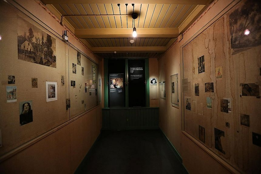 Inside the Anne Frank House Museum in Amsterdam, the Netherlands, are the swinging bookcase (left) which conceals the door into the secret annex, corridors lined with old photos (below) and rooms with old furniture (right).