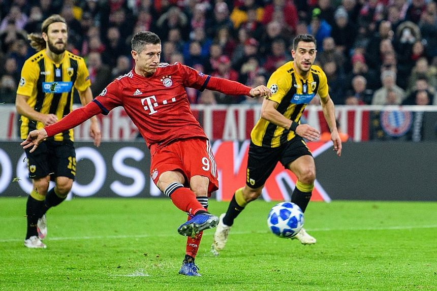 Bayern Munich's Robert Lewandowski, scoring from the spot against AEK Athens last month, will carry the German champions' chances against Liverpool in the Champions League last 16. The Polish forward leads the competition in scoring with eight goals,