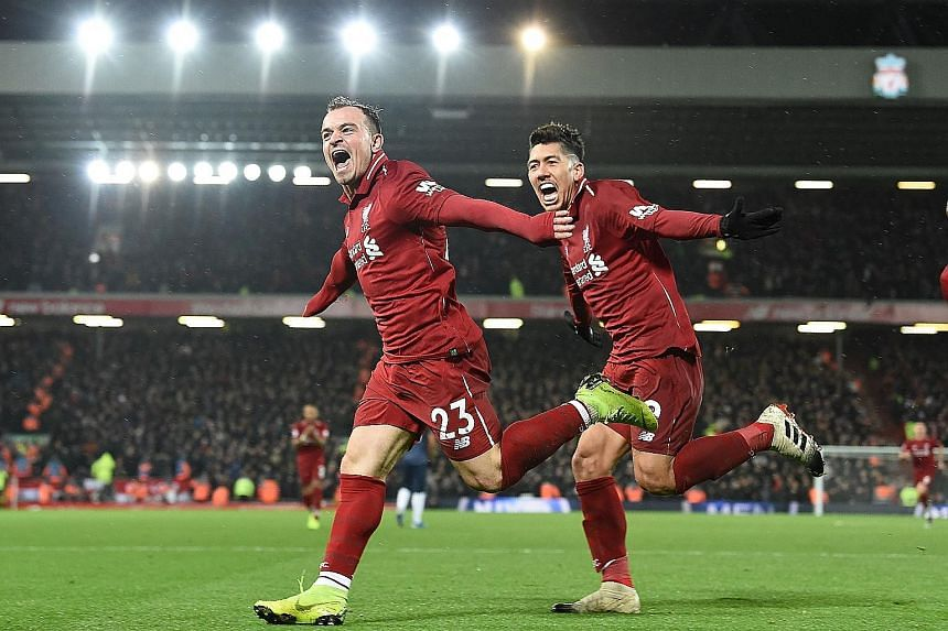 Liverpool's match-winner Xherdan Shaqiri celebrating his second goal against Manchester United with teammate Roberto Firmino at Anfield. It was the Swiss playmaker's fifth league goal of the season.