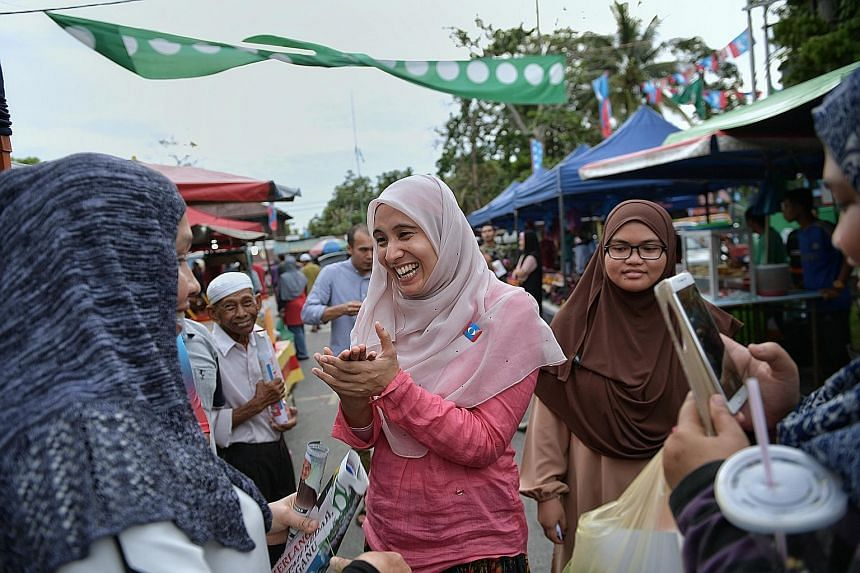 Ms Nurul Izzah Anwar meeting residents at a night market in Permatang Pauh in Penang in May, ahead of the general election. The three-term MP, who currently represents Permatang Pauh, did not explain why she was resigning, but said she would continue