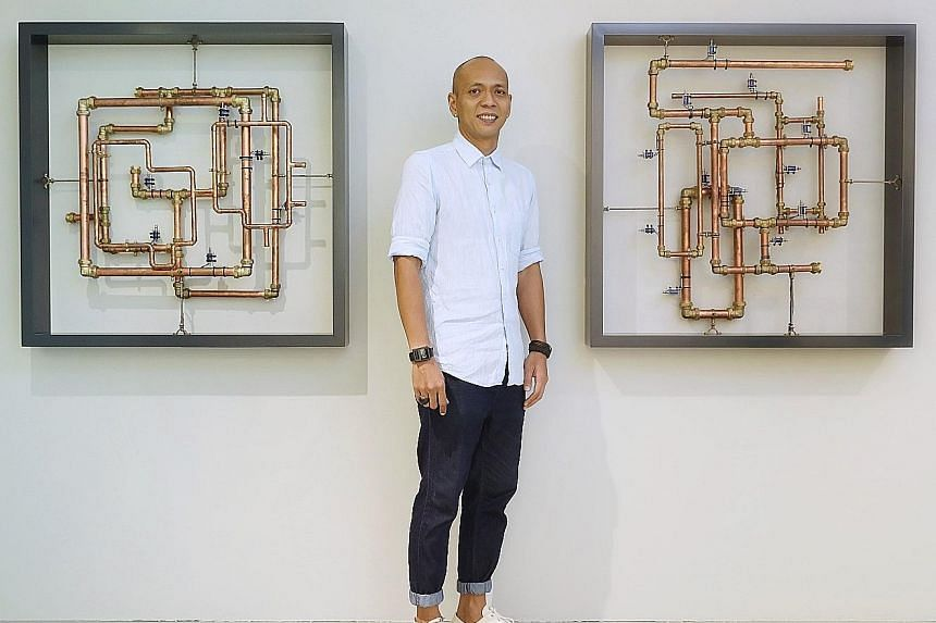 Sound artist Zul Mahmod with his work, Resonance In Frames, a three-part installation where solenoids hammer away at copper pipes, starting out with a series of sharp, rhythmic clanks.