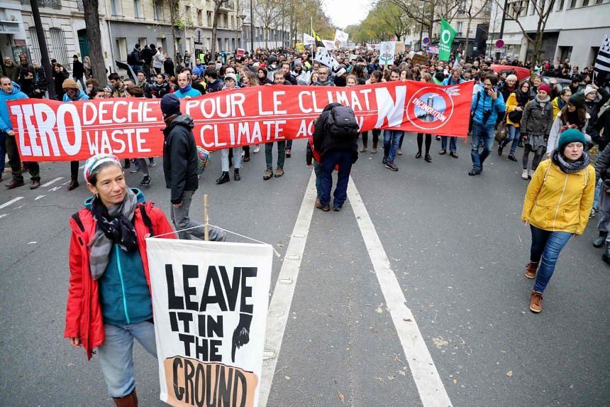 People take part in a march against climate change, in Paris, on Dec 8, 2018.