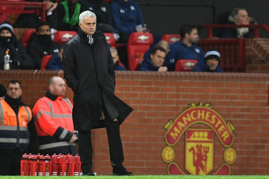Manchester United's former manager Jose Mourinho looks on during the English Premier League football match between Manchester United and Fulham at Old Trafford in Manchester, on Dec 8, 2018.