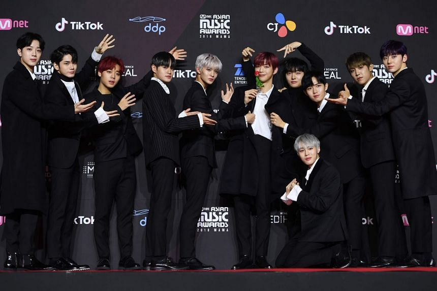 Three fans of K-pop group Wanna One (pictured) bought plane tickets to get on the same flight as the band, took pictures of them, then demanded to get off and got refunds on their tickets.