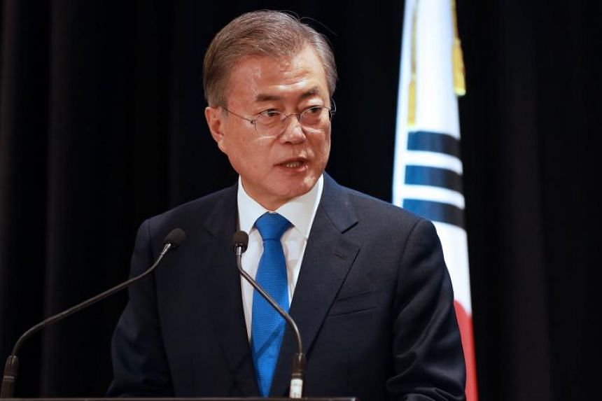 South Korean President Moon Jae-in said the government should aggressively remove hurdles to corporate investment.