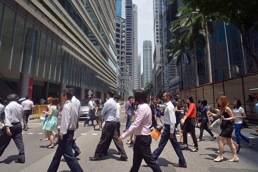 File photo showing office workers at Singapore's central business district.