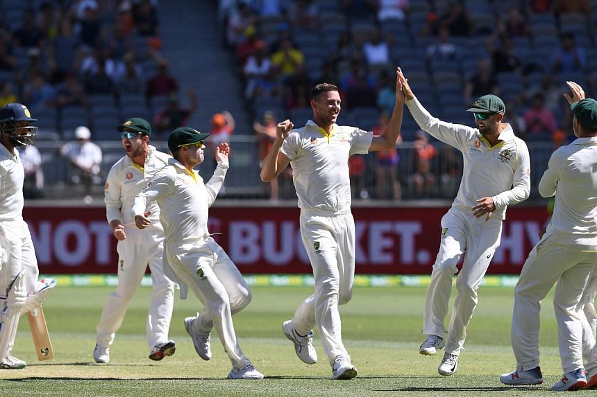 Australia's Josh Hazlewood (centre) celebrates with his teammates on day four of the second test match between Australia and India on Dec 17, 2018.