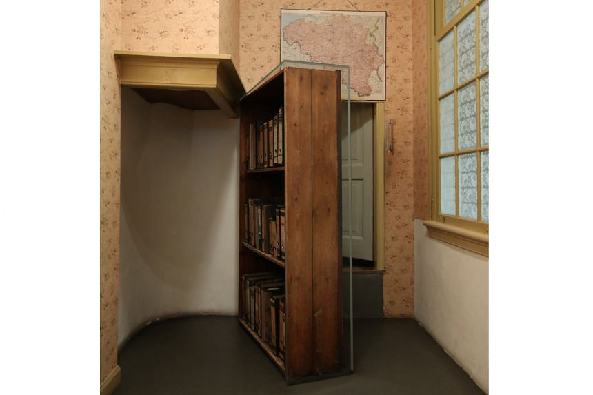 Inside the Anne Frank House Museum in Amsterdam, the Netherlands, are the swinging bookcase (above) which conceals the door into the secret annex, corridors lined with old photos and rooms with old furniture.