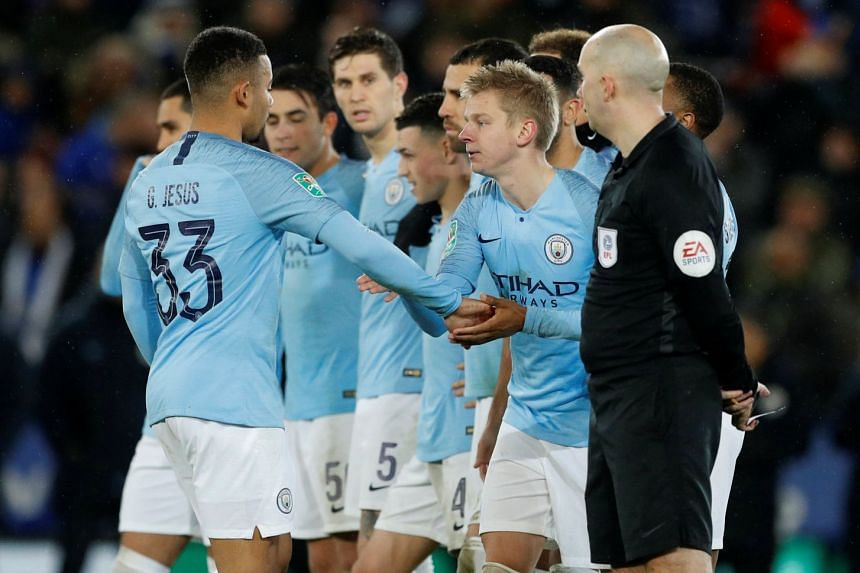 Manchester City's Oleksandr Zinchenko and team mates during the penalty shootout.
