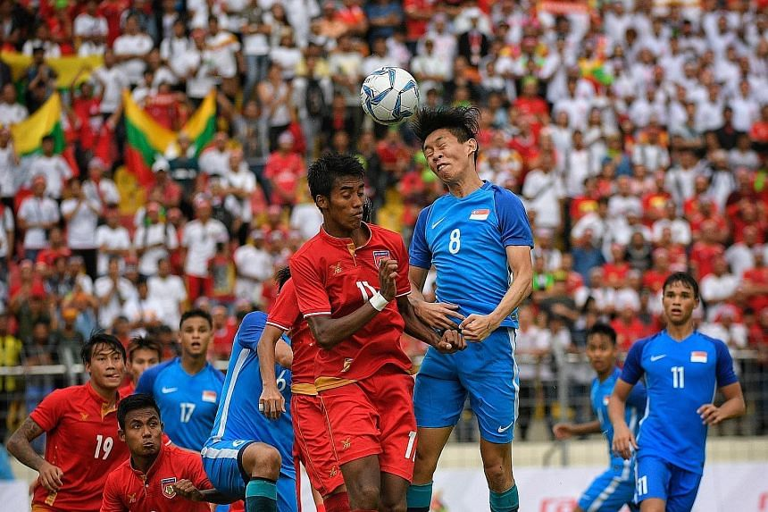 Singapore's Joshua Pereira going for the ball with Myanmar's Maung Maung Lwin during the SEA Games in Kuala Lumpur last year. Despite the Young Lions blocking a possible move to Albirex Niigata, he may still activate the exit clause in his contract i