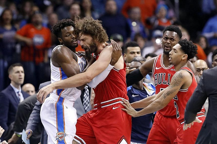 Oklahoma City Thunder forward Jerami Grant (far left) getting into a tussle with Robin Lopez of the Chicago Bulls during the National Basketball Association game at Chesapeake Energy Arena on Monday night. The Thunder won 121-96 and climbed to third