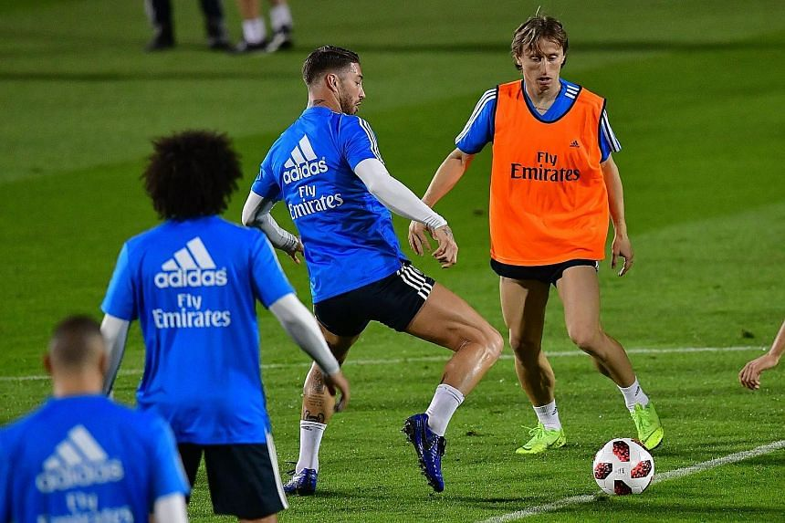 Real Madrid midfielder Luka Modric (right) and defender Sergio Ramos in training before today's Club World Cup semi-final clash with J-League side Kashima Antlers.
