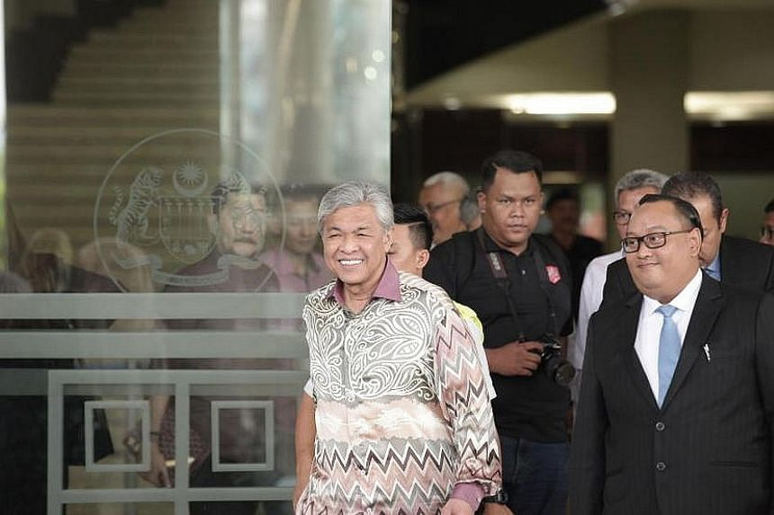 Umno president Ahmad Zahid Hamidi is facing more than 40 charges in court, including for criminal breach of trust and graft. Umno's deputy president Mohamad Hasan, the former menteri besar of Negeri Sembilan, will take over Zahid's duties.