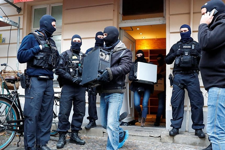 """Policemen in Berlin searching As-Sahaba mosque, where the cleric Abul Baraa preaches. He is suspected of sending money to an Islamist fighter in Syria """"for purchasing military equipment"""", according to the General Prosecutor's Office. The mosque is sa"""