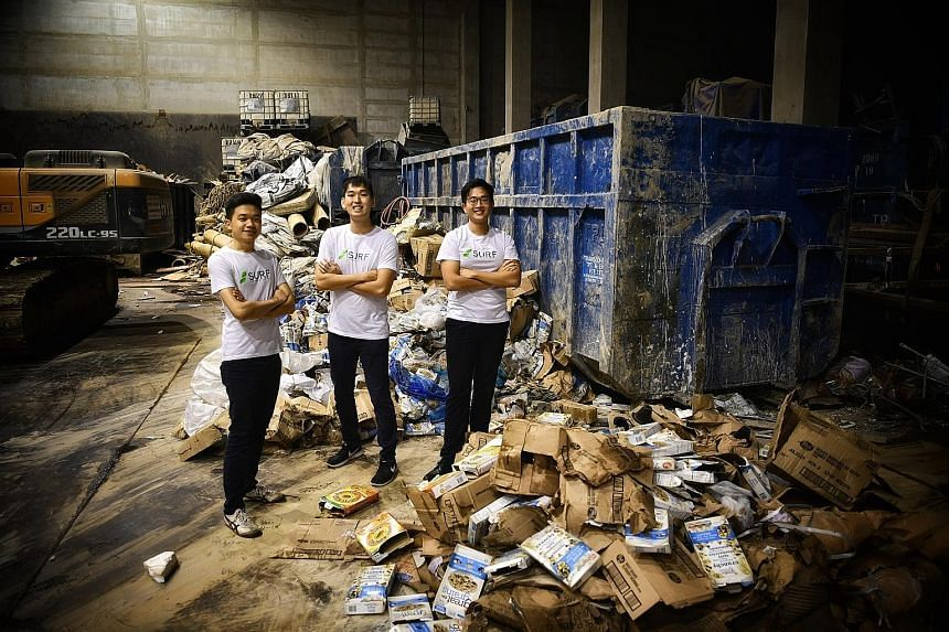 NTU undergraduates (main picture, from left) Ang Wei Loong, Wong Song Wei and Lek Zhi Yu created an app (left) that uses a points system to encourage people to recycle. They also started a company, Surf, to run recycling drives in firms.