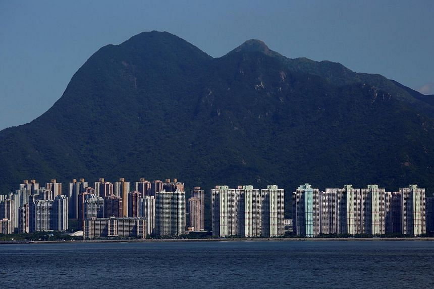 Residential apartments are seen under Ma On Shan peak in Hong Kong on Aug 29, 2017.