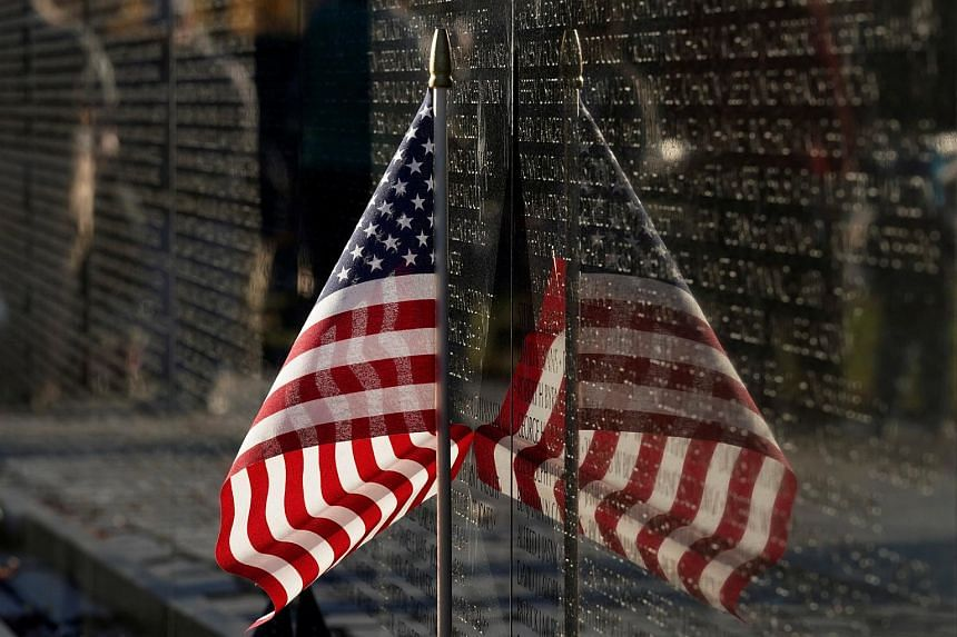 A US flag is placed beside the Vietnam Veterans Memorial on Veteran's Day in Washington, US, on Nov 11, 2018.