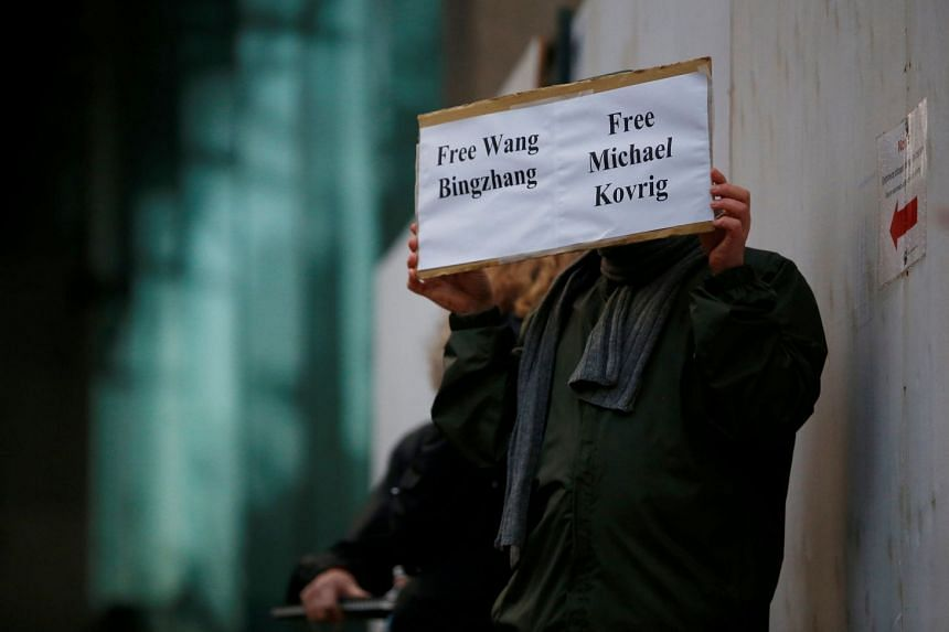 A demonstrator at the BC Supreme Court bail hearing of Huawei CFO Meng Wanzhou in Vancouver on Dec 11, 2018. Mr Michael Kovrig is one of the Canadians detained by China earlier this month, while Wang Bingzhang is a political activist jailed in China