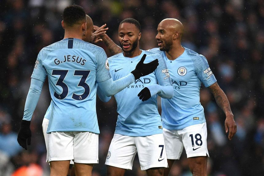 Racist abuse was directed at Manchester City's Raheem Sterling (centre).