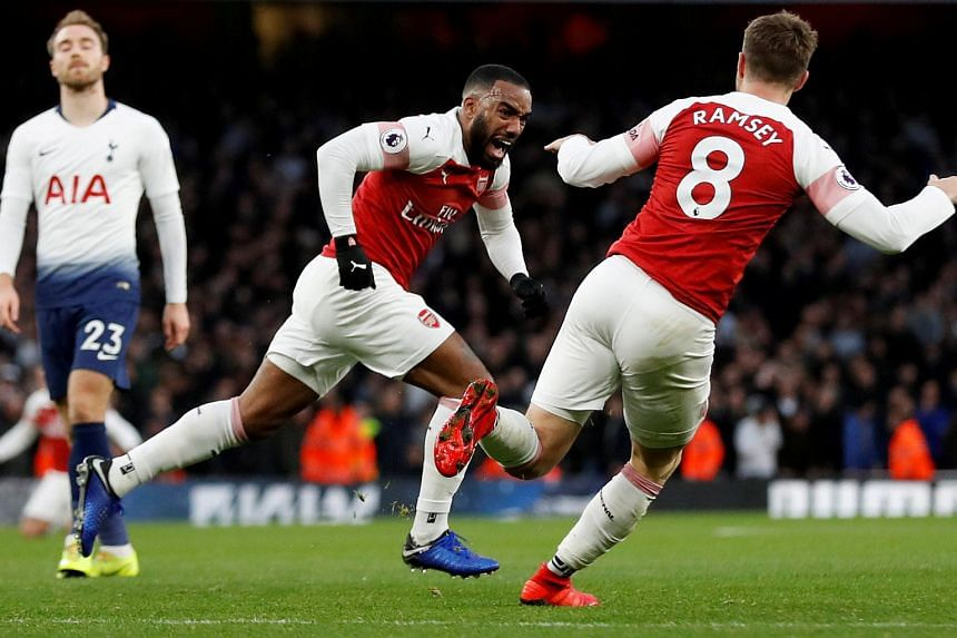 Alexandre Lacazette celebrates scoring their third goal.