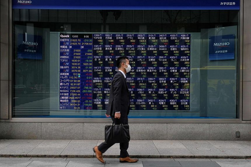 Stocks in Japan recovered early losses and those in Hong Kong edged up, while Australian shares underperformed.