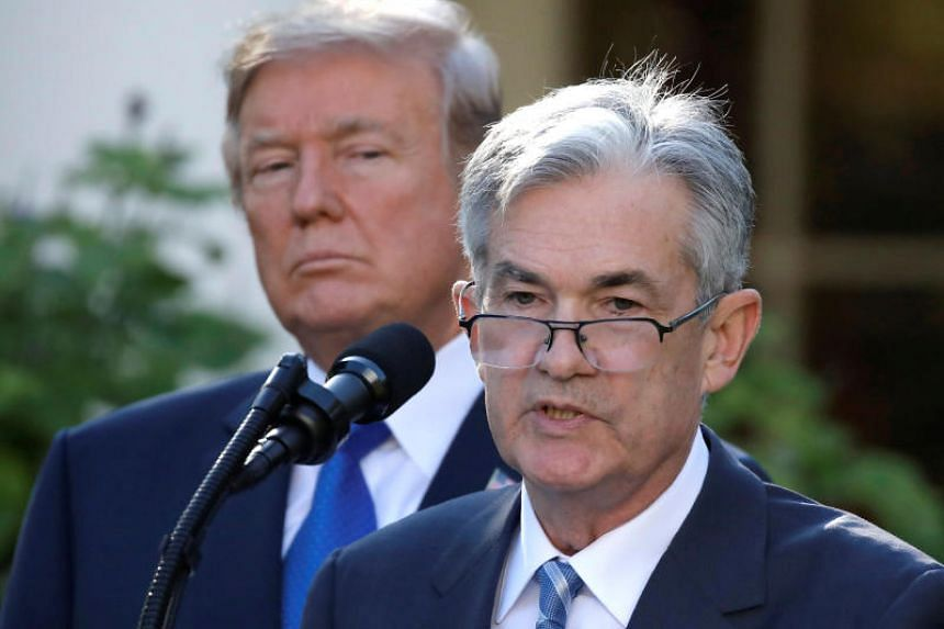 US President Donald Trump looks on as Fed chief Jerome Powell speaks. Trump has repeatedly broken with the norm respected by US presidents of recent decades who refrained from criticising the Fed.