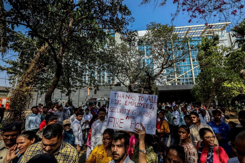 An employee of the government-run ESIC Kamgar hospital in Mumbai with a placard thanking hospital staff and firefighters for saving the lives of people on the hospital premises after it caught fire on Monday. The cause of the blaze is not yet known b