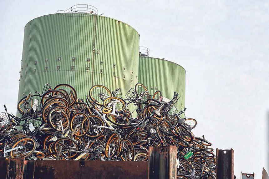 Bicycles from oBike stacked up in the compound of Enviro-Hub Holdings in July. The shared-bike industry saw a shake-out after nearly two years, with pioneer oBike making a surprise exit in June.