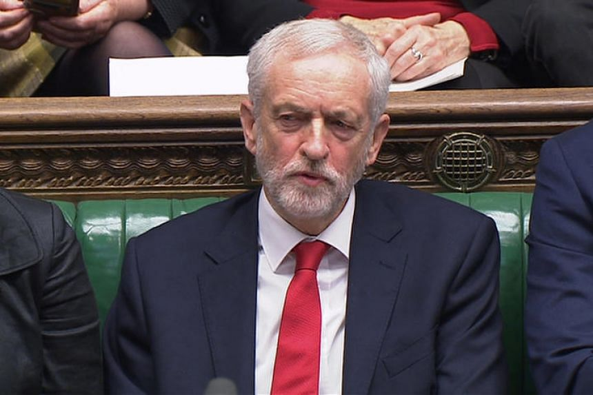 Labour Party's leader Jeremy Corbyn could be seen appearing to mouth the words in response to British Prime Minister Theresa May making a joke about his failure to demand a no-confidence vote against her government.
