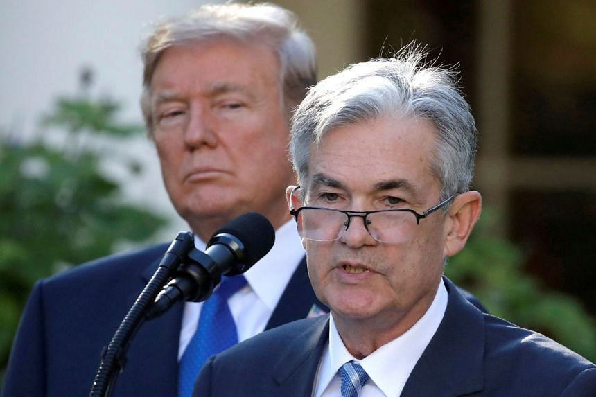 US President Donald Trump looks on as Jerome Powell speaks at the White House.